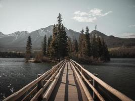 Wooden bridge to an island photo