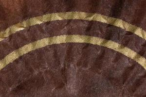 Brown paper background with yellow stripes