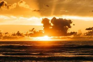 Stormy sea against sundown sky