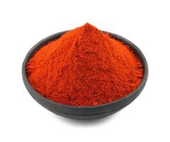 Red chili pepper powder on white background photo