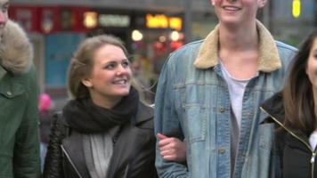 Slow Motion Sequence Of Friends Shopping Outdoors Together video