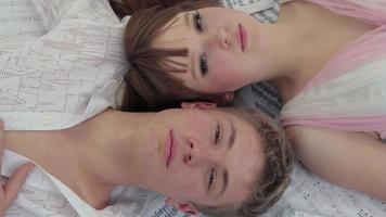 Young Man And Woman Lying Together. Open Eyes video