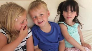 Three Children Sitting On Sofa Together At Home video