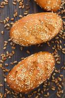 Tasty fresh bun with seeds photo
