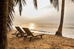 Beautiful beach at sunrise in paradise