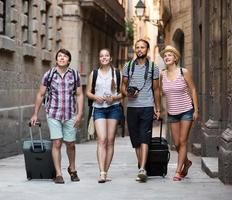 Travelers with travel bags walking photo