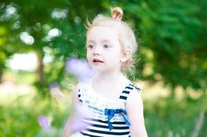 Baby girl outdoors photo