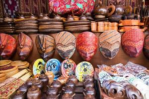 Masks and other artifacts in palm wood photo