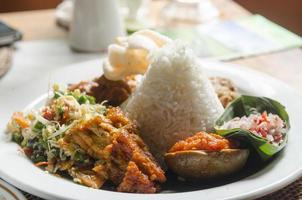 nasi lemack style dish fresh vegetables and fish with rice