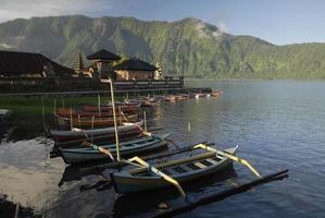 Lake Bratan with outrigger canoes at Pura Ulun Danu, Bali
