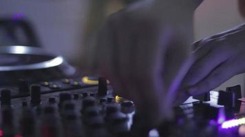 Close-up of female dj hands at the deck night club. video