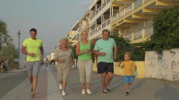 Cheerful big family going in for sport together