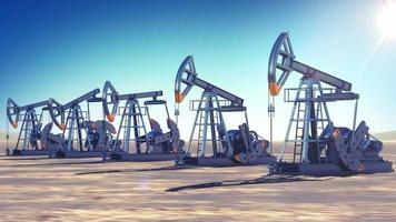 Oil Pumps at work in the desert. Sun Shining. Looped 3d animation. Business and Production Concept.