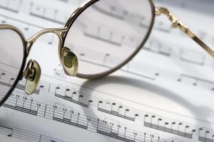 CU of glasses on sheet music