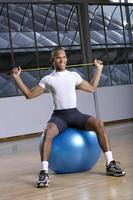 Man sitting on a fitness ball.