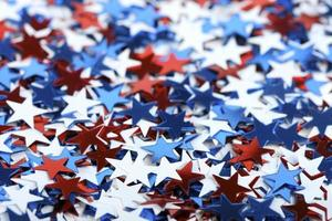 White, red and blue confetti with star shape photo