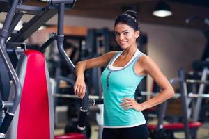 Woman standing in fitness gym