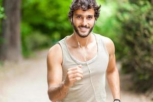 Portrait of a guy doing fitness outdoors photo