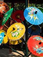 Colorful rice paper umbrella dried in nature.