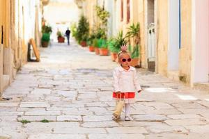 cute little princess walking on the street of Europe