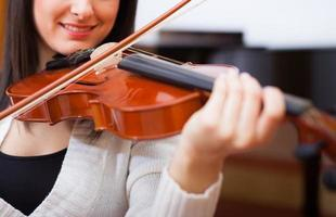 Violinist playing her instrument photo