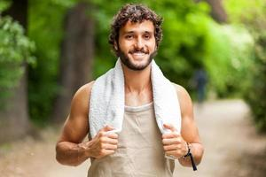 Portrait of a guy doing fitness outdoors