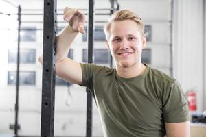 Smiling man rests in fitness gym center
