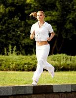 Athletic Runner Training in a park. Fitness Girl Running outdoors