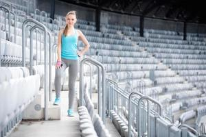 Woman preparing for training on stadium, fitness training. gym workout