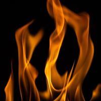 Beautiful yellow fire flames on black photo