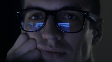 man watching nude content on internet reflection on glasses