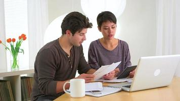Man and woman figuring out their finances