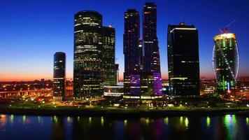 Modern office buildings by river, Moscow, Russia, time-lapse.