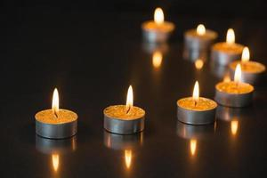 Eight small candles burning