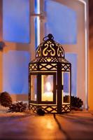 Christmas lantern with glowing candle