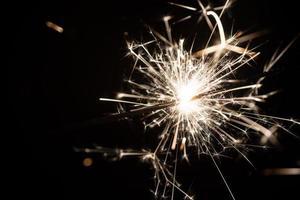 sparkler or Bengal fire - scattering sparks photo