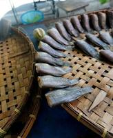 Bamboo baskets and Dried fish photo