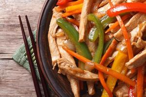 chicken with vegetables macro and chopsticks top view