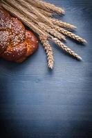 vertical version ears of wheat and sweet bun