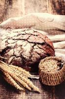 Fresh bread on wooden table,vintage filter