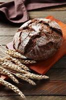 Delicious brown bread on the board photo