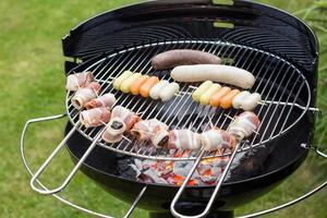Barbecue filled with raw meat photo