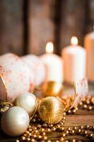 Christmas decorations with candles on wooden background photo