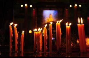 Yellow candle in a row at the Chinese temple photo