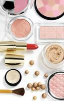 cosmetics on white background with light shadows photo