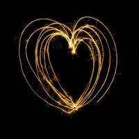 Sparkler firework light with heart shape. photo