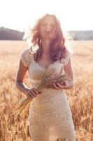 Girl in wheat field on the wind. Person and nature photo