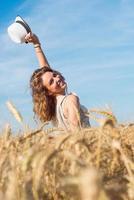 Woman in wheat field photo