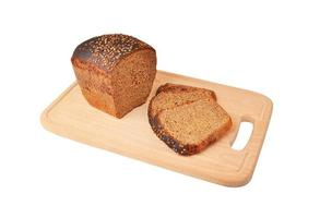 The cut loaf of bread on wooden board photo