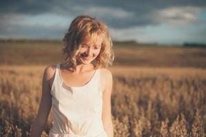 Woman portrait in a field photo
